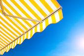 Yellow-white stripped awning.
