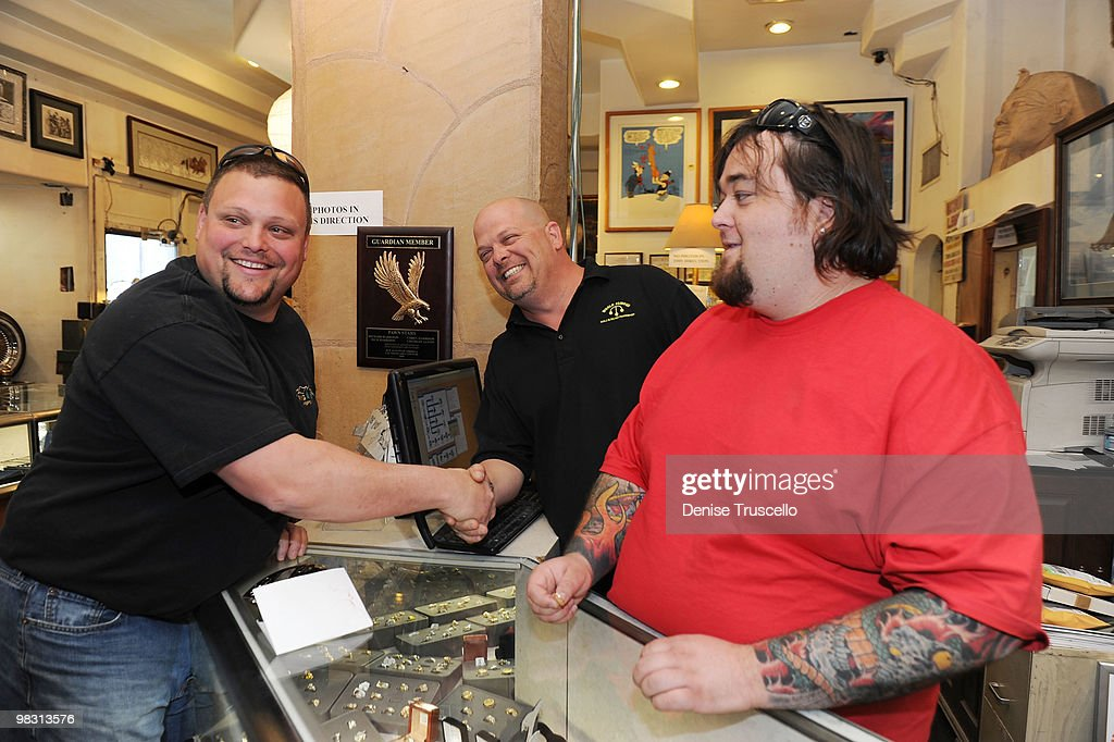 'Ax Men's' Gabe Rygaard poses for a photo with 'Pawn Stars' Rick Harrison and Austin 'Chumlee' Russell at Gold and Silver Pawn on April 7, 2010 in Las Vegas, Nevada.