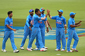 Axar Patel of India celebrates the wicket of Moeen Ali of England with team mates during the One Day International match between England and India at...