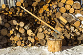 Axe chopping woods, pieces of woods ready for winter home cabin fire