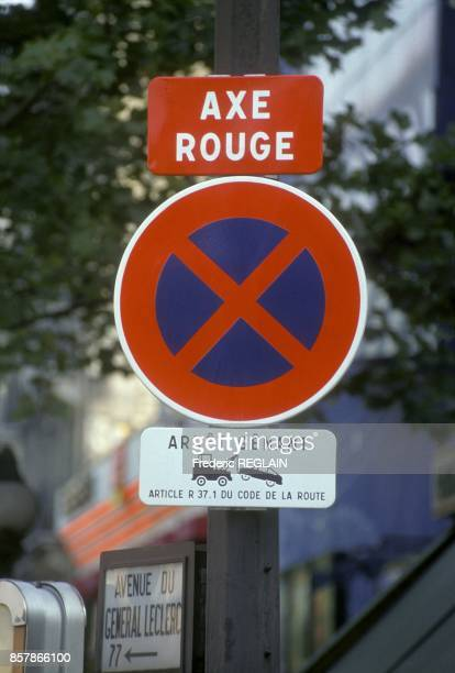 Axe rouge sign or red lane roadsign indicating that no stop is allowed on a street in September 1990 in Paris France