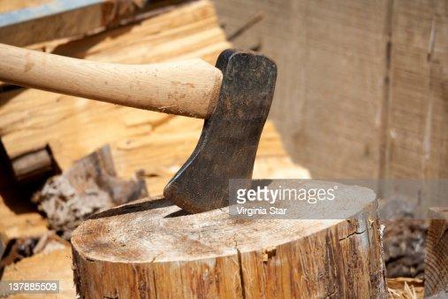 Axe stuck on log : Stock Photo