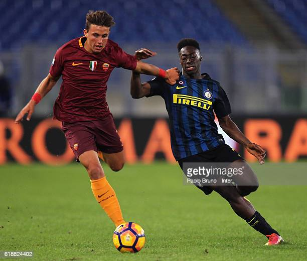 Axel Bakayoko of FC Internazionale competes for the ball with Luca Pellegrini of AS Roma during the Primavera Supercup final match between AS Roma...