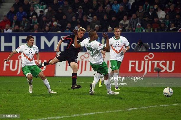 Axel Bellinghausen of Augsburg scores his team's first goal during the Bundesliga match between FC Augsburg and SV Werder Bremen at SGL Arena on...
