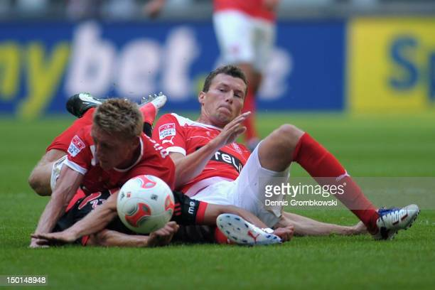 Axel Bellinghausen of Duesseldorf and teammate Oliver Fink challenge Enzo Perez of Lissabon during the friendly match between Fortuna Duesseldorf and...