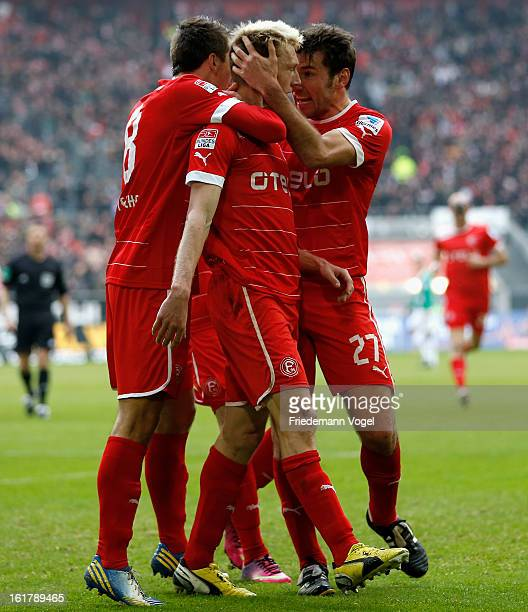 Axel Bellinghausen of Duesseldorf celebrates scoring the opening goal with Robert Tesche and Stefan Reisinger during the Bundesliga match between...