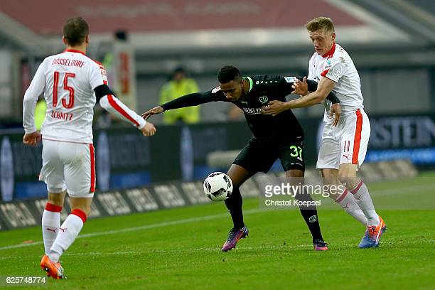 Axel Bellinghausen of Duesseldorf challenges Noah Joel Sarenren Bazee of Hannover during the Second Bundesliga match between Fortuna Duesseldorf and...