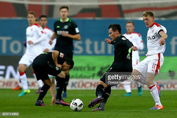 Axel Bellinghausen of Duesseldorf challenges Stefan Strandberg of Hannover during the Second Bundesliga match between Fortuna Duesseldorf and...