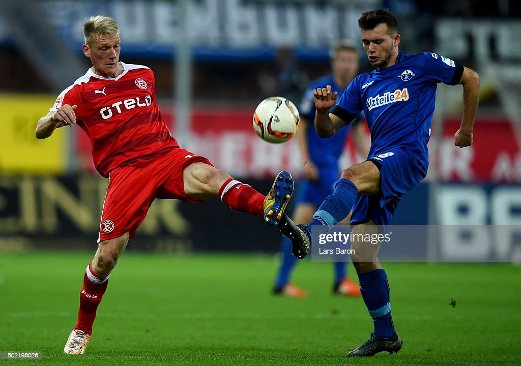 Axel Bellinghausen of Duesseldorf is challenged by Kevin Stoeger of Paderborn during the Second Bundesliga match between SC Paderborn and Fortuna...