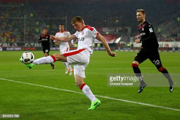 Axel Bellinghausen of Duesseldorf kicks a ball and Kacper Przybylko of Kaiserslautern watches him during the Second Bundesliga match between Fortuna...