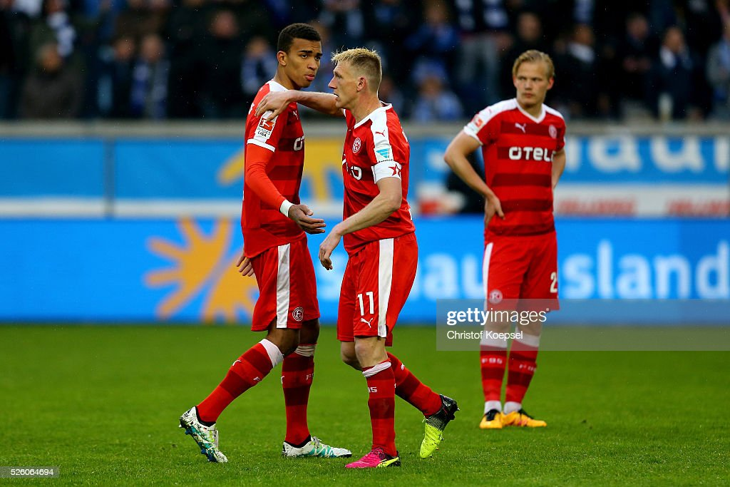 Axel Bellinghausen of Duesseldorf (C) talks to Kevin Akpoguma (L) during the 2. Bundesliga match between MSV Duisburg and Fortuna Duesseldorf at Schauinsland-Reisen-Arena on April 29, 2016 in Duisburg, Germany.