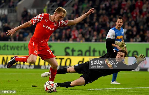 Axel Bellinghausen of Fortuna Duesseldorf is challenged by Michael Esser of VfL Bochum during the Second Bundesliga match between Fortuna Duesseldorf...