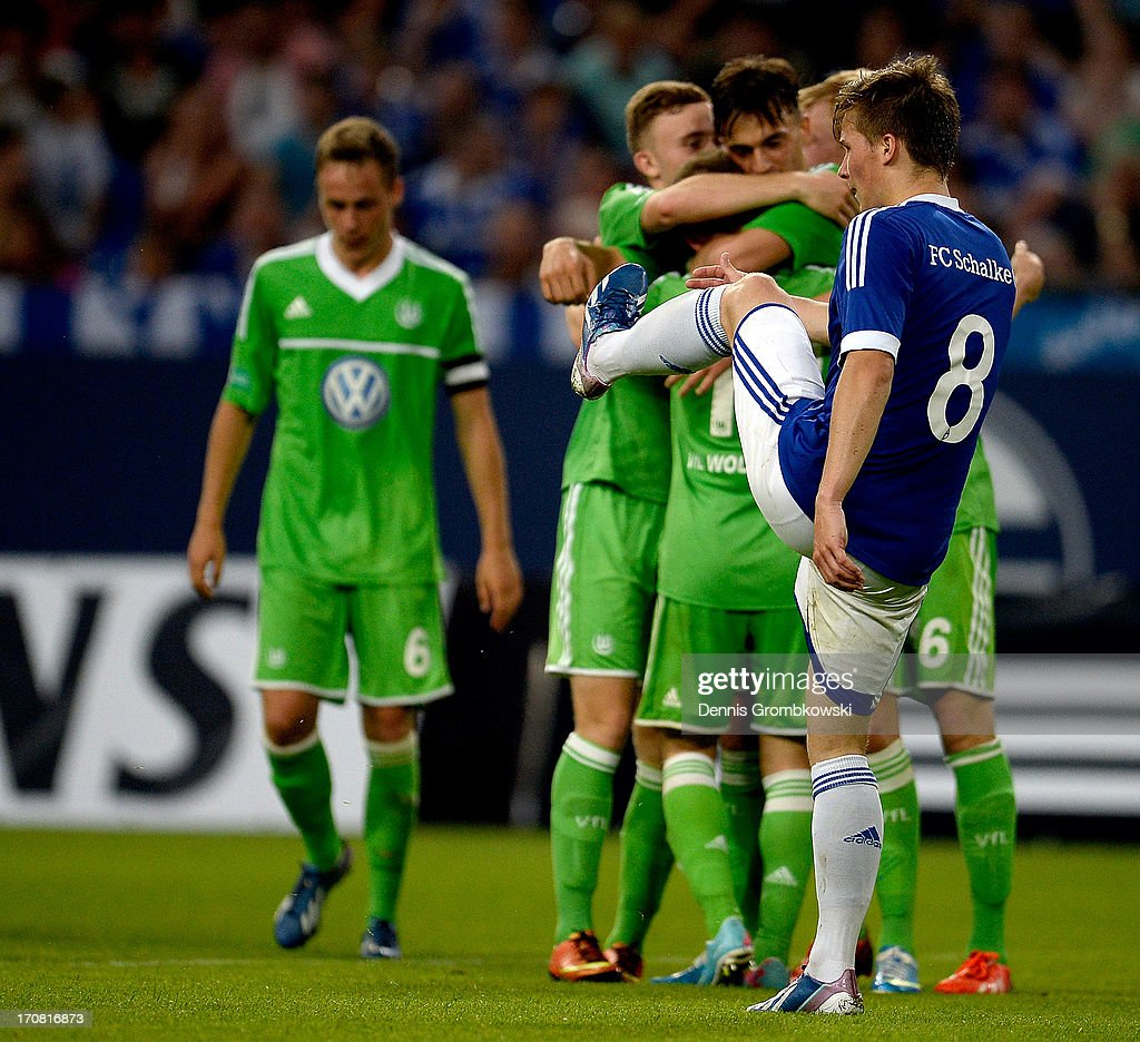 Axel Borgmann of Schalke reacts while Wolfsburg players celebrate a goal during the A Juniors Championships semifinal second leg match between Schalke 04 and VfL Wolfsburg at Veltins-Arena on June 18, 2013 in Gelsenkirchen, Germany.