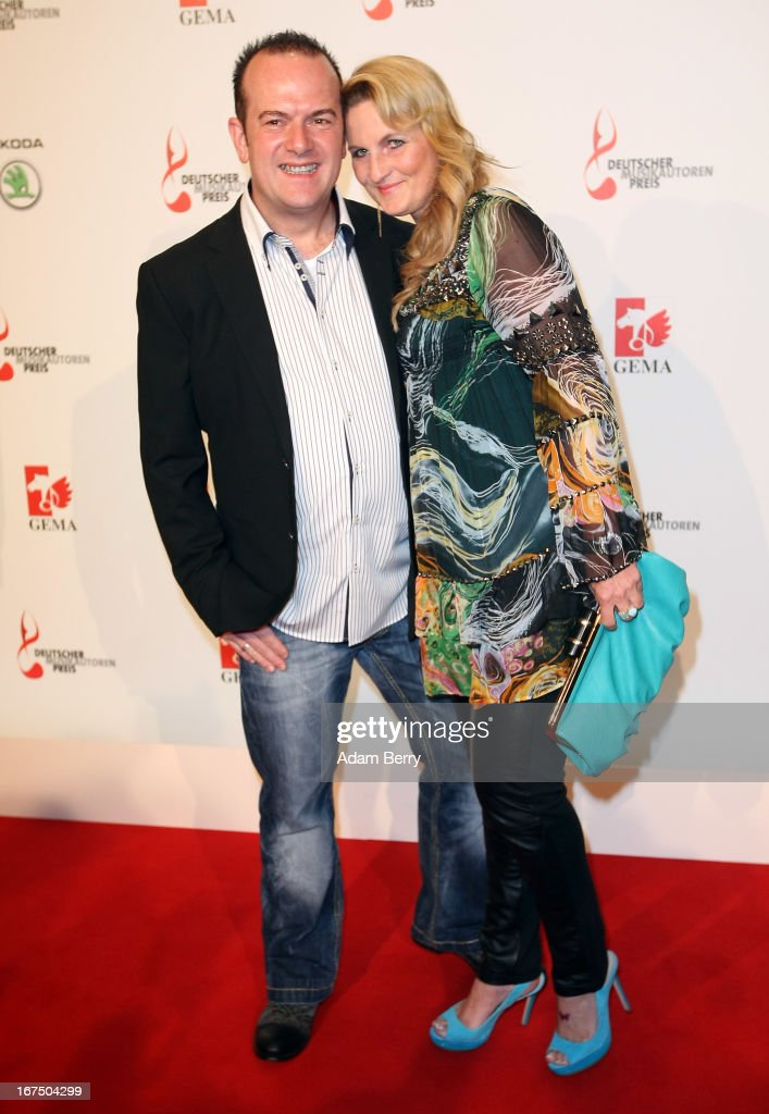 Axel Coon, formerly of the band Scooter (L), and his wife arrive for the Deutscher Musikautorenpreis (German Songwriter Prize) 2013 ceremony at the Ritz Carlton hotel on April 25, 2013 in Berlin, Germany. The prize has been presented by GEMA (Gesellschaft fuer musikalische Auffuehrungs- und mechanische Vervielfaeltigungsrechte), the German society for musical performing and mechanical reproduction rights, since 2009.