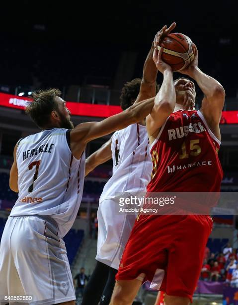 Axel Hervelle and Jonathan Tabu of Belgium in action against Timofey Mozgov of Russia during the FIBA Eurobasket 2017 Group D Men's basketball match...