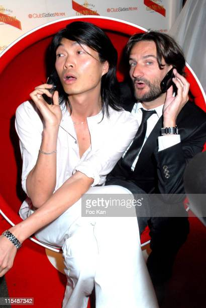Axel Huynh and Frederic Beigbeder during Champagne Mumm Sixties Party at Castel Club in Paris France
