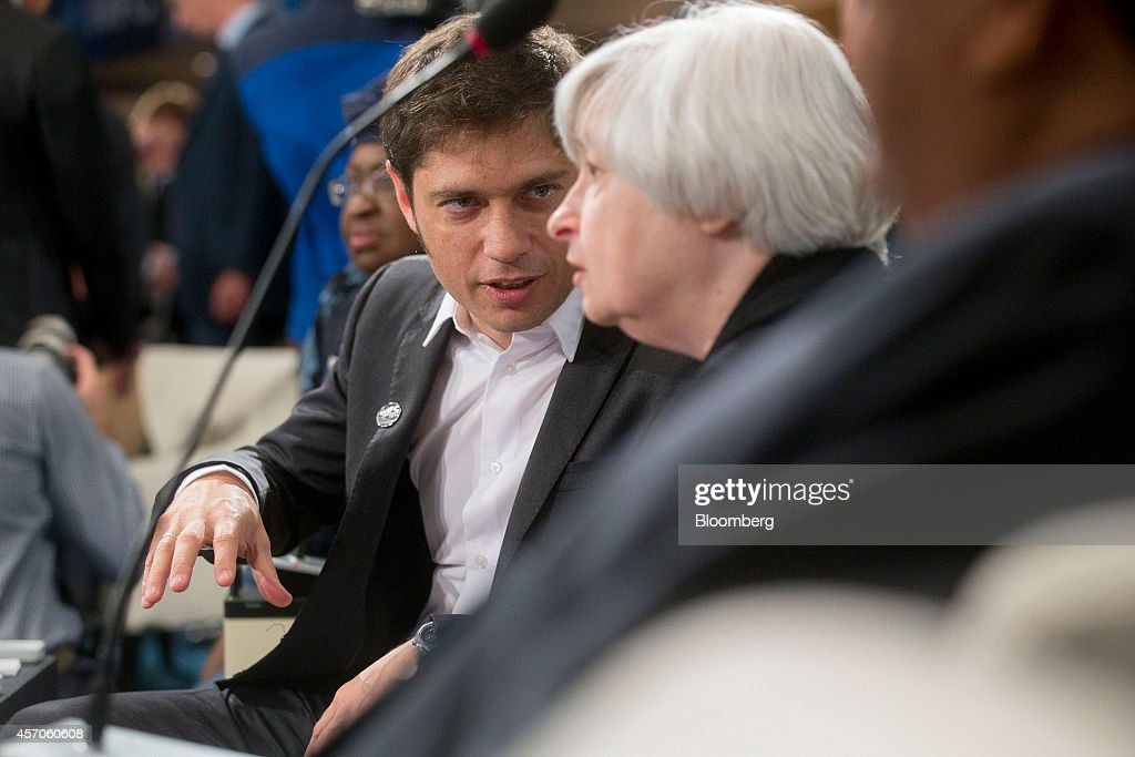 <a gi-track='captionPersonalityLinkClicked' href=/galleries/search?phrase=Axel+Kicillof&family=editorial&specificpeople=9189054 ng-click='$event.stopPropagation()'>Axel Kicillof</a>, Argentina's minister of economy, left, talks to <a gi-track='captionPersonalityLinkClicked' href=/galleries/search?phrase=Janet+Yellen&family=editorial&specificpeople=2731344 ng-click='$event.stopPropagation()'>Janet Yellen</a>, chair of the U.S. Federal Reserve, during an International Monetary Fund Committee (IMFC) governors meeting at the International Monetary Committee (IMF) and World Bank Group Annual Meetings in Washington, D.C., U.S., on Saturday, Oct. 11, 2014. U.S. Treasury Secretary Jacob J. Lew warned global policy makers against devaluing exchange rates for competitive advantage amid mounting concern over the strength of the dollar and slowing world growth. Photographer: Andrew Harrer/Bloomberg via Getty Images