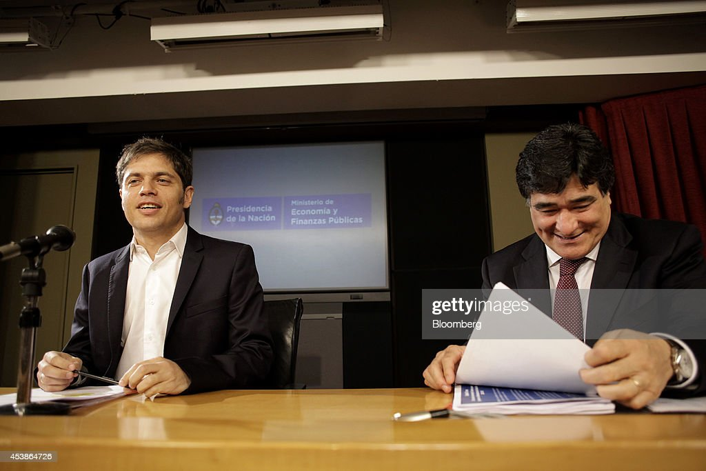 <a gi-track='captionPersonalityLinkClicked' href=/galleries/search?phrase=Axel+Kicillof&family=editorial&specificpeople=9189054 ng-click='$event.stopPropagation()'>Axel Kicillof</a>, economy minister for Argentina, left, smiles during a news conference with Carlos Zannini, Argentina's legal secretary, in Buenos Aires, Argentina, on Wednesday, Aug. 20, 2014. Kicillof said the government is aware that some bondholders of certain series of debt may be looking to accelerate payments. Photographer: Diego Levy/Bloomberg via Getty Images