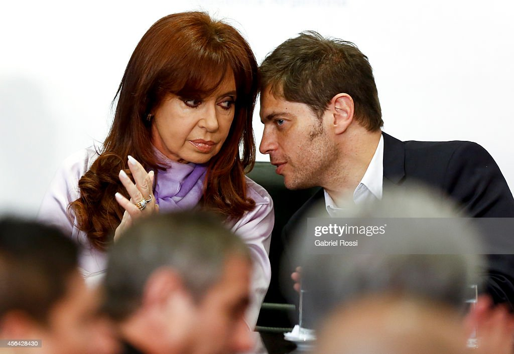 <a gi-track='captionPersonalityLinkClicked' href=/galleries/search?phrase=Axel+Kicillof&family=editorial&specificpeople=9189054 ng-click='$event.stopPropagation()'>Axel Kicillof</a> Minister of Economy talks to President of Argentina <a gi-track='captionPersonalityLinkClicked' href=/galleries/search?phrase=Cristina+Fernandez+de+Kirchner&family=editorial&specificpeople=565499 ng-click='$event.stopPropagation()'>Cristina Fernandez de Kirchner</a> during a press conference at the Presidential Palace on September 30, 2014 in Buenos Aires, Argentina. After United States judge Thomas Griesa held Argentina in contempt of court on September 29th, Fernandez made reference to Griesa's decision on the bond payment case.