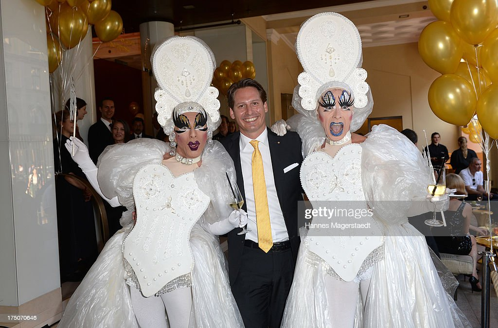 Axel Ludwig and artists pose during the Sommerfest Eclat Dore at Hotel Vier Jahreszeiten on July 30, 2013 in Munich, Germany.
