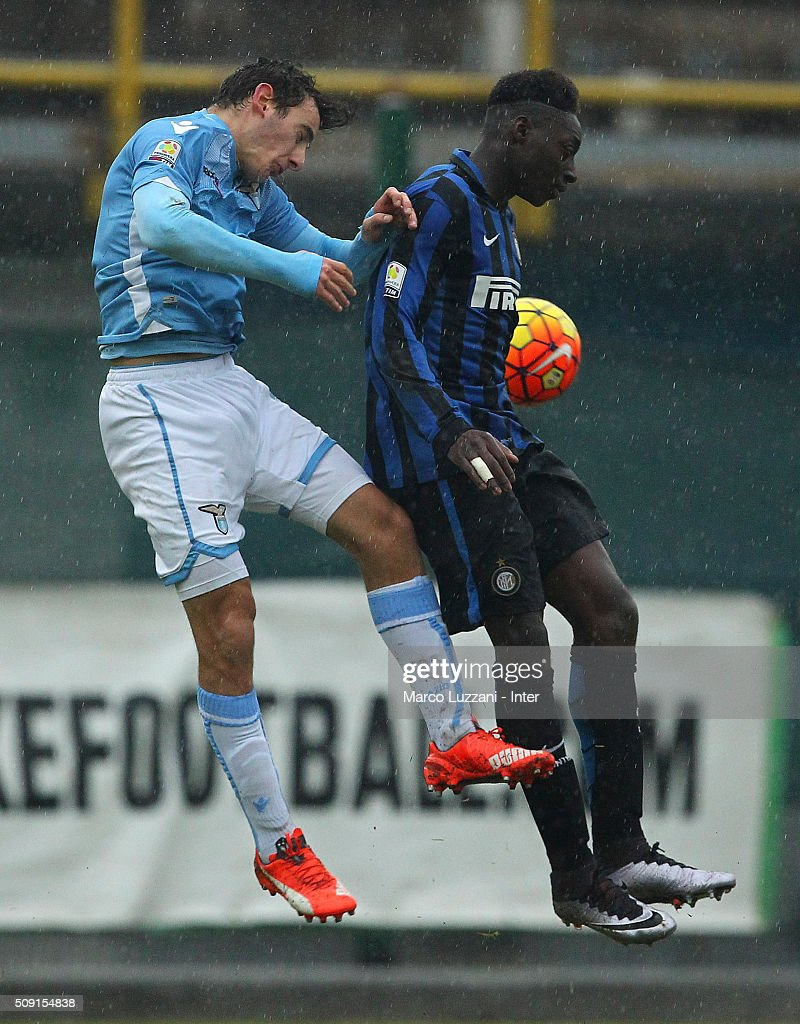 Axel Mohamed Bakayoko (R) of FC Internazionale Milano competes for the ball with Luca Germoni (L) of SS Lazio during the juvenile TIM cup match between FC Internazionale and SS Lazio at Stadio Breda on February 9, 2016 in Sesto San Giovanni, Italy.
