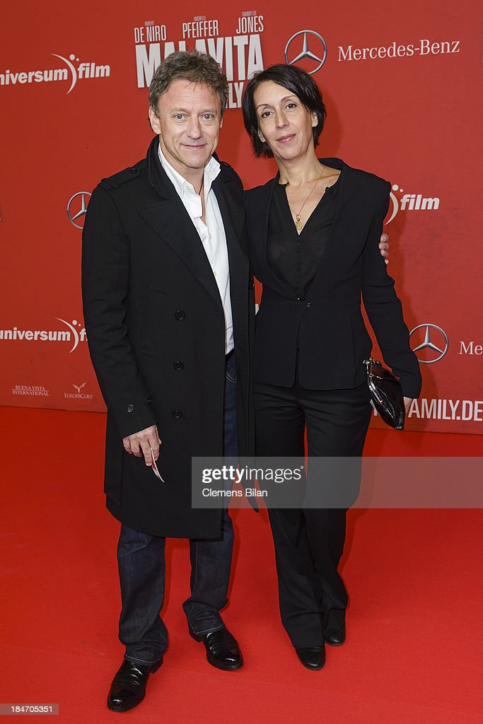 Axel Pape and Gioia Raspe attend the 'Malavita' premiere at Kino in der Kulturbrauerei on October 15, 2013 in Berlin, Germany.