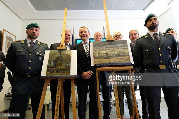 Axel Ruger Director of the Van Gogh museum poses next to two recently recovered stolen paintings by late Dutch artist Vincent Van Gogh entitled...
