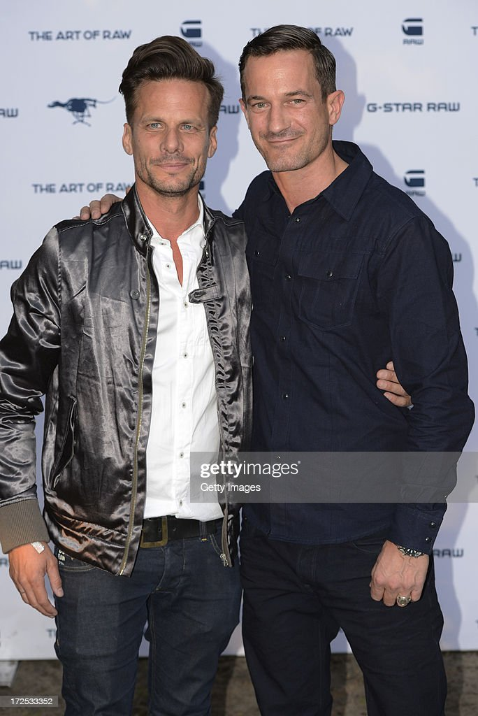 Axel Schukies, country manager Germany and international account director of G-Star Raw (L) and <a gi-track='captionPersonalityLinkClicked' href=/galleries/search?phrase=Soenke+Moehring&family=editorial&specificpeople=760953 ng-click='$event.stopPropagation()'>Soenke Moehring</a> attend G-Star presents Spring/Summer 2014 collection during Bread & Butter on July 02, 2013 in Berlin, Germany.
