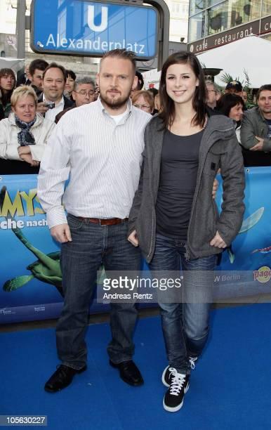 Axel Stein and Lena MeyerLandrut attend the 'Sammy's Abenteuer' Premiere at Cubix Alexanderplatz on October 17 2010 in Berlin Germany