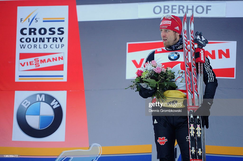 <a gi-track='captionPersonalityLinkClicked' href=/galleries/search?phrase=Axel+Teichmann&family=editorial&specificpeople=773876 ng-click='$event.stopPropagation()'>Axel Teichmann</a> of Germany looks on after winning the FIS Tour de Ski Oberhof Men's 15km Classic Pursuit at DKB Ski Arena on December 30, 2011 in Oberhof, Germany.