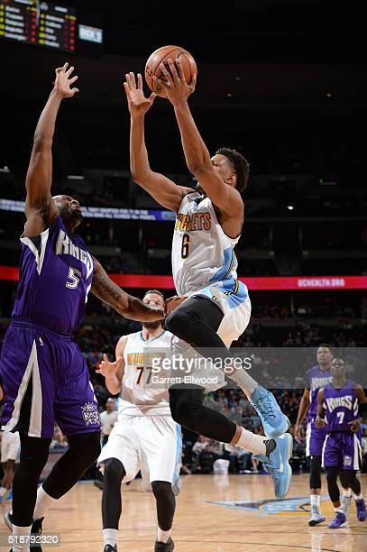 Axel Toupane of the Denver Nuggets goes for the layup against the Sacramento Kings during the game on April 2 2016 at Pepsi Center in Denver Colorado...