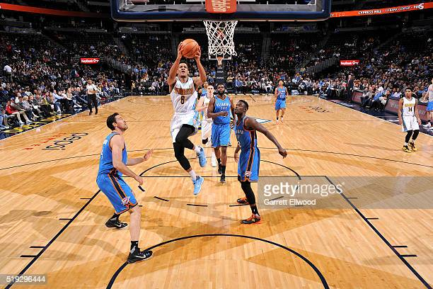 Axel Toupane of the Denver Nuggets goes for the layup during the game against the Oklahoma City Thunder on April 5 2016 at the Pepsi Center in Denver...