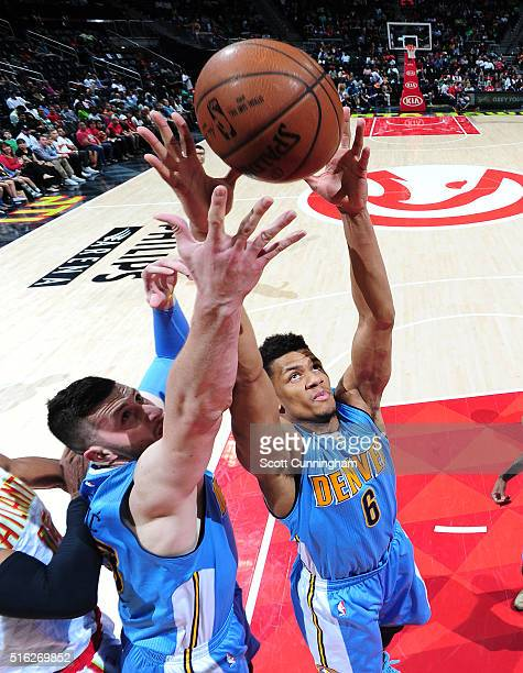 Axel Toupane of the Denver Nuggets grabs the rebound against the Atlanta Hawks on March 17 2016 at Philips Arena in Atlanta Georgia NOTE TO USER User...