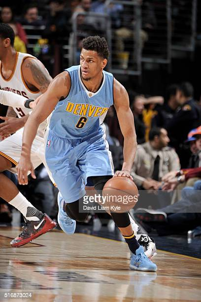 Axel Toupane of the Denver Nuggets handles the ball against the Cleveland Cavaliers on March 21 2016 at Quicken Loans Arena in Cleveland Ohio NOTE TO...