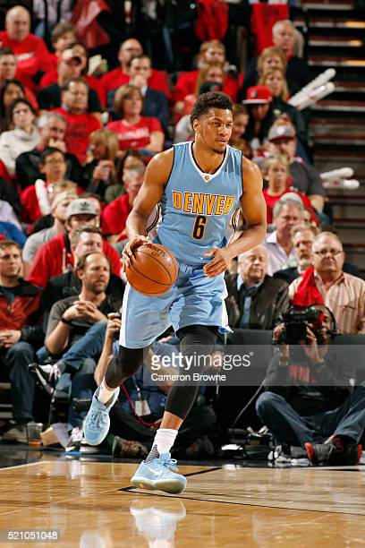 Axel Toupane of the Denver Nuggets runs up the court against the Portland Trail Blazers during the game on April 13 2016 at Moda Center in Portland...