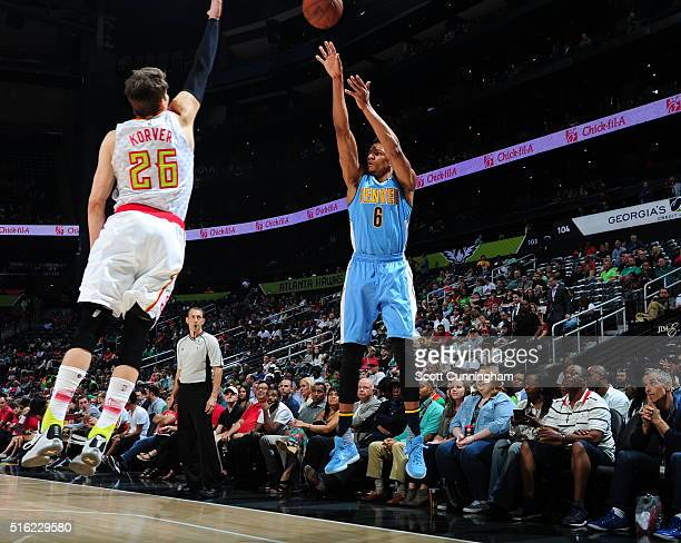 Axel Toupane of the Denver Nuggets shoots the ball against the Atlanta Hawks on March 17 2016 at Philips Arena in Atlanta Georgia NOTE TO USER User...