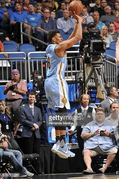 Axel Toupane of the Denver Nuggets shoots the ball against the Orlando Magic on March 15 2016 at the Amway Center in Orlando Florida NOTE TO USER...