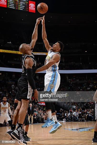 Axel Toupane of the Denver Nuggets shoots the ball against the San Antonio Spurs on April 8 2016 at the Pepsi Center in Denver Colorado NOTE TO USER...