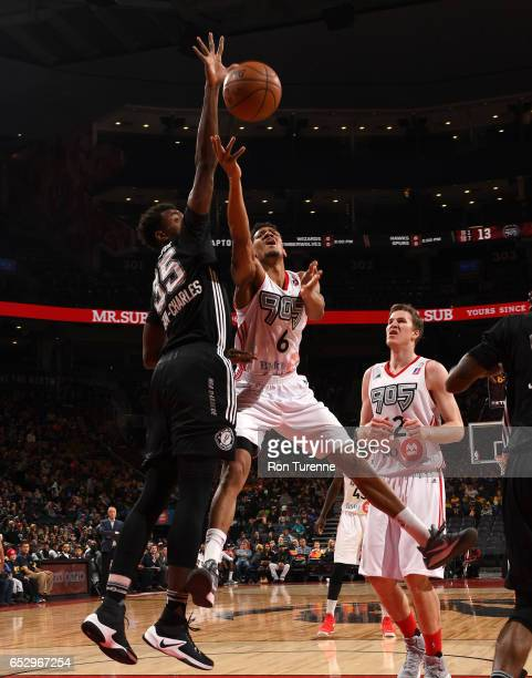 Axel Toupane of the Raptors 905 fights for the ball against Livio JeanCharles of the Austin Spurs at the Air Canada Centre on March 13 2017 in...