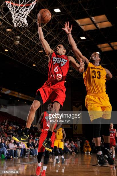 Axel Toupane of the Raptors 905 goes up for the shot against Jonathan Holmes of the Canton Charge at the Canton Memorial Civic Center on April 5 2017...
