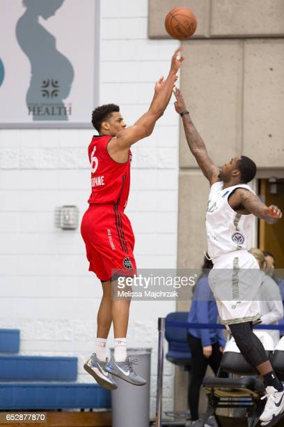 Axel Toupane of the Raptors 905 puts the shot up over Jaylen Bland of the Salt Lake City Stars at Bruins Arena on March 10 2017 in Taylorsville Utah...