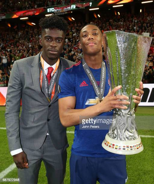 Axel Tuanzebe and Anthony Martial of Manchester United celebrate with the Europa League trophy after the UEFA Europa League Final match between...