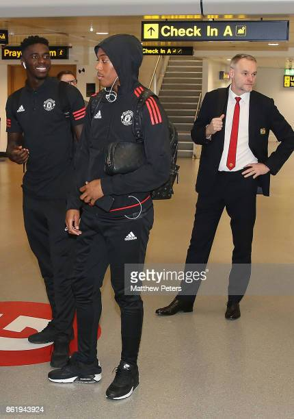 Axel Tuanzebe and Anthony Martial of Manchester United check in ahead of their flight to Lisbon for the UEFA Champions League match against Benfica...