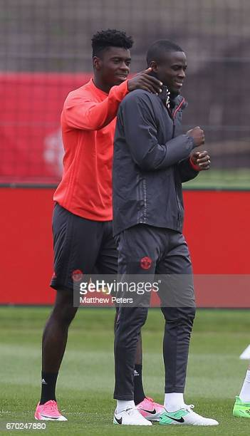 Axel Tuanzebe and Eric Bailly of Manchester United in action during a first team training session at Aon Training Complex on April 19 2017 in...
