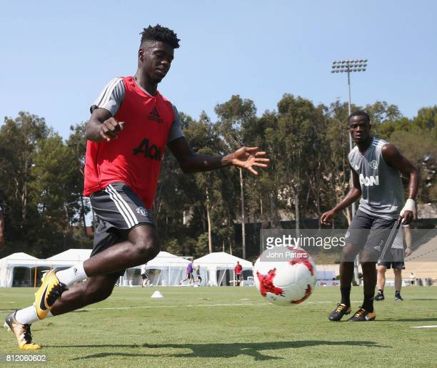 Axel Tuanzebe and Eric Bailly of Manchester United in action during a first team training session as part of their preseason tour of the United...