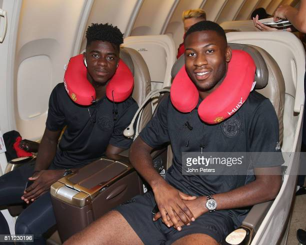 Axel Tuanzebe and Timothy FosuMensah of Manchester United sit on the aeroplane ahead of the club's preseason tour of the USA at Manchester Airport on...