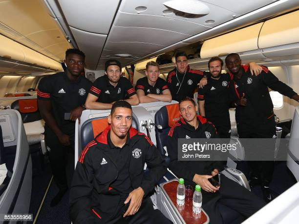 Axel Tuanzebe Daley Blind Chris Smalling Scott McTominay Joel Pereira Nemanja Matic Juan Mata and Eric Bailly of Manchester United pose on the plane...