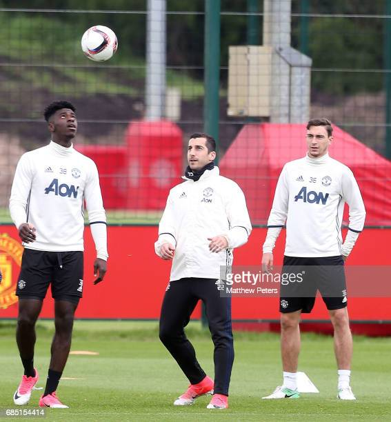 Axel Tuanzebe Henrikh Mkhitaryan and Matteo Darmian of Manchester United in action during a first team training session at Aon Training Complex on...