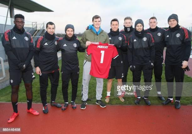 Axel Tuanzebe Henrikh Mkhitaryan Juan Mata Ander Herrera Scott McTominay Daley Blind Phil Jones and Victor Lindelof of Manchester United pose with...