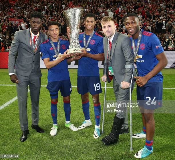 Axel Tuanzebe Jesse Lingard Marcus Rashford Luke Shaw and Timothy FosuMensah of Manchester United celebrate with the Europa League trophy after the...